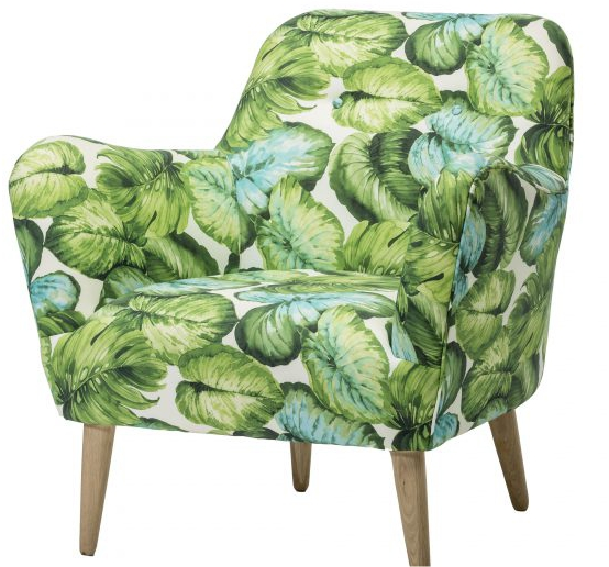 An occasional chair covered in large tropical leaves