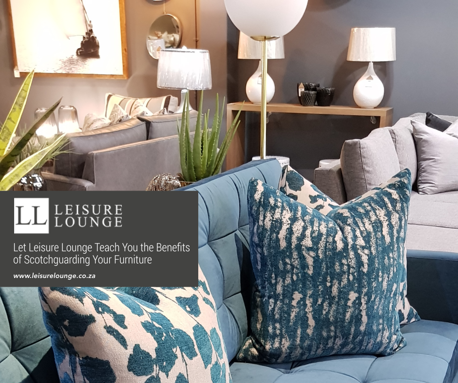 Teal couch with throw pillows